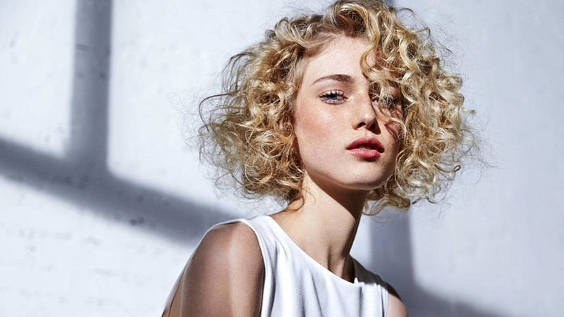 30 Easy Hairstyles For Short Curly Hair – The Trend Spotter Pertaining To Blonde Pixie Haircuts With Curly Bangs (View 24 of 25)