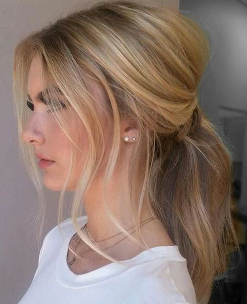 Featured Photo of Loose Low Ponytail Hairstyles With Casual Side Bang