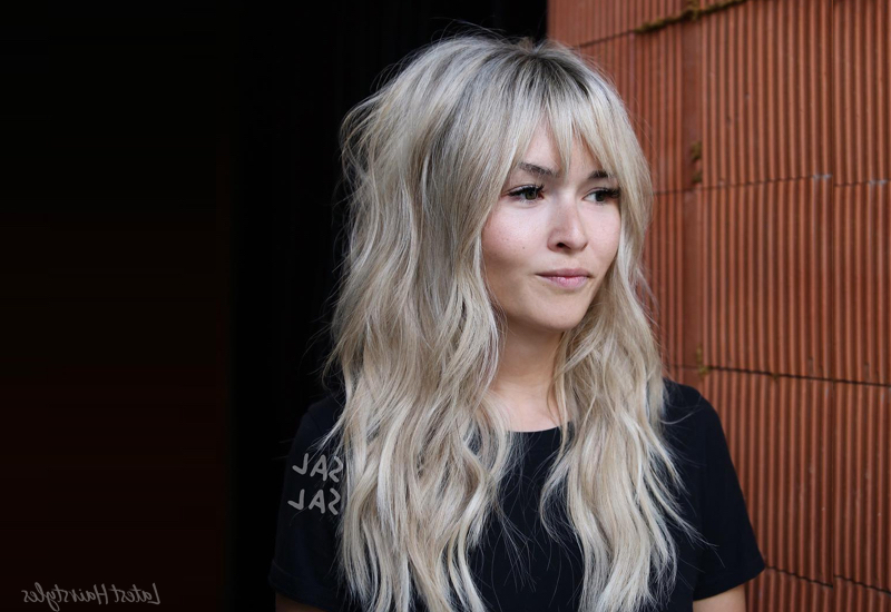 38 Flattering Long Hair With Bangs Hairstyles (2019 Trends) Throughout Messy Voluminous Ponytail Hairstyles With Textured Bangs (View 20 of 25)