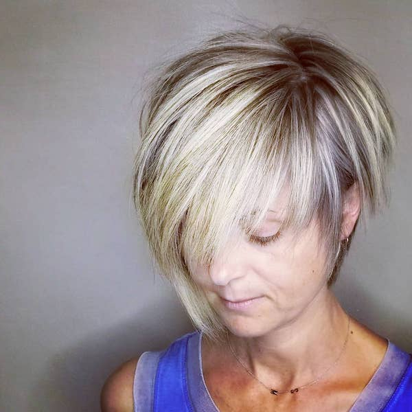 49 Feather Cut Hairstyles For Short, Medium, And Long Hair Pertaining To Layered And Outward Feathered Bob Hairstyles With Bangs (View 10 of 25)