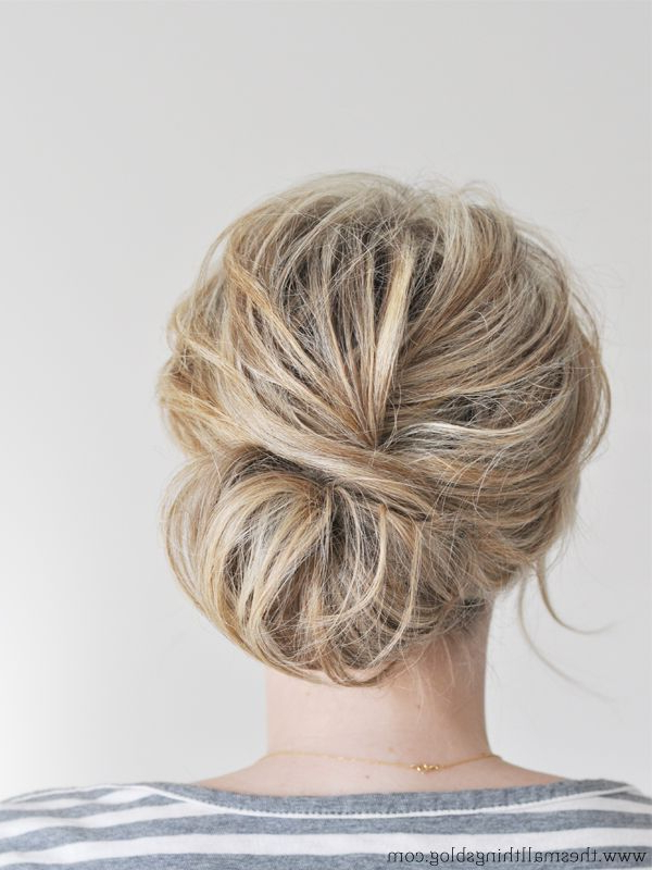 From Top Knots To Sock Buns: Bun Hairstyles For Any Occasion Intended For Messy Updo Hairstyles With Free Curly Ends (View 8 of 25)