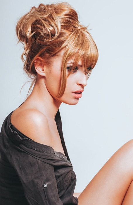 The Best Messy Bun Hairstyles For Every Hair Length – The Intended For Messy Voluminous Ponytail Hairstyles With Textured Bangs (View 8 of 25)