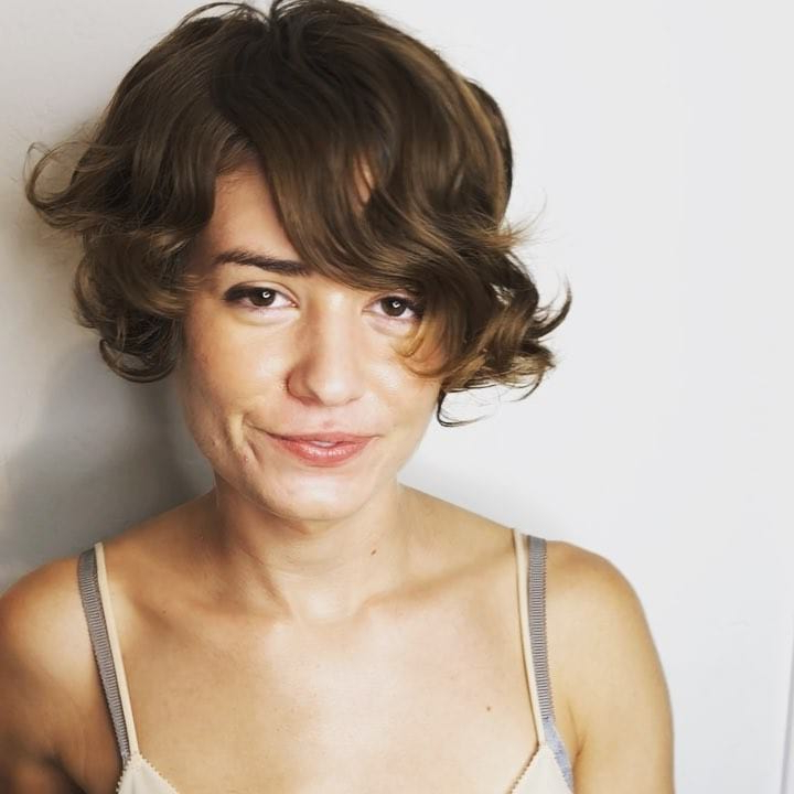 Women's Brunette Asymmetric Pixie Bob With Long Side Swept Inside Messy Short Bob Hairstyles With Side Swept Fringes (View 19 of 25)