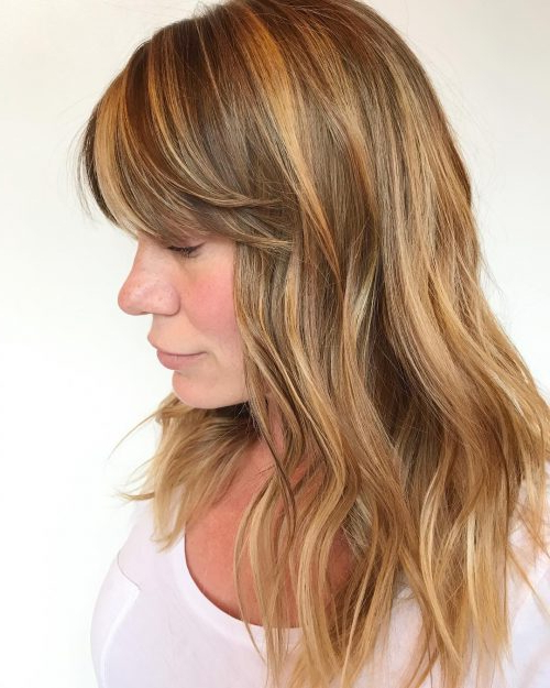 18 Hottest Layered Haircuts With Bangs For 2019 Intended For Feathered Haircuts With Angled Bangs (View 13 of 25)