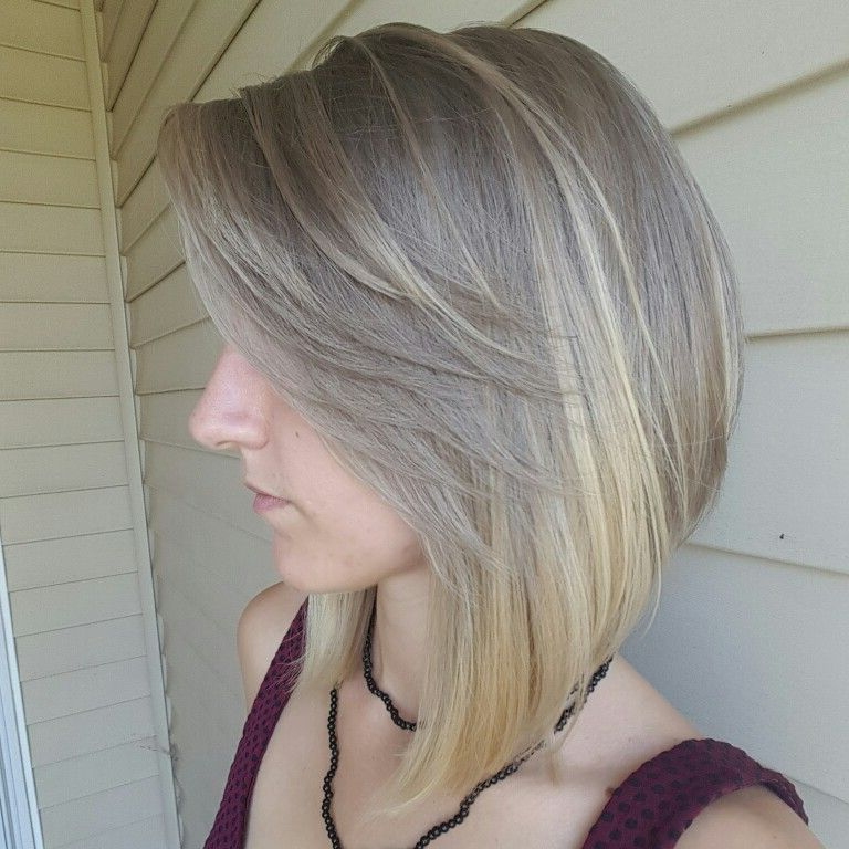 Featured Photo of Feathered Haircuts With Angled Bangs