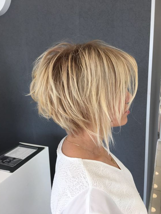 Picture Of A Cute Shaggy Inverted Bob Haircut With Bangs In regarding Shaggy Blonde Bob Hairstyles With Bangs
