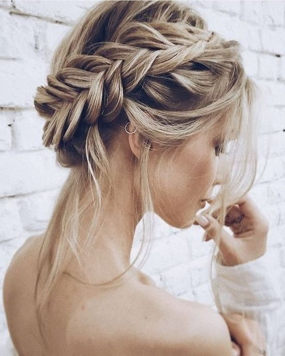 Picture Of A Dimension Fishtail Halo Braided Updo With Some regarding Most Current Updo Halo Braid Hairstyles