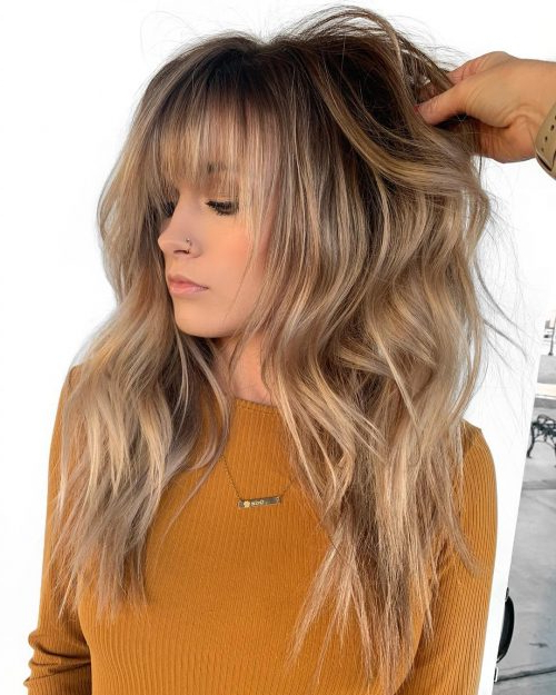 15 Feather Cut Hairstyle Ideas: Advice From Stylists Throughout Best And Newest Long Curtain Feathered Bangs Hairstyles (View 6 of 25)