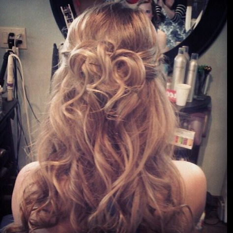 Loose Half Up With Rosette Like Curls (View 21 of 25)