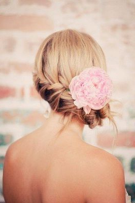 Side French Braid In A Loose Bun With Flower   Wedding With Most Recent Loose Double Braids Hairstyles (View 13 of 25)