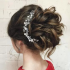 Large Curly Bun Bridal Hairstyles With Beaded Clip
