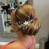 Sleek Bridal Hairstyles With Floral Barrette (Photo 1 of 25)