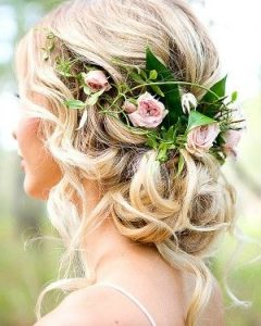 Bohemian Curls Bridal Hairstyles With Floral Clip
