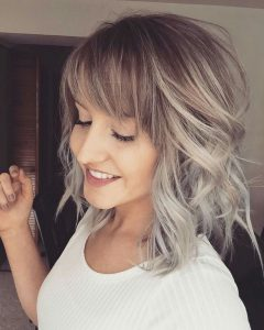 Curly Ash Blonde Updo Hairstyles With Bouffant And Bangs