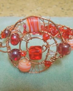 Ponytail Wrapped In Copper Wire And Beads