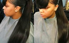 Low Black Ponytail Hairstyles With Bangs